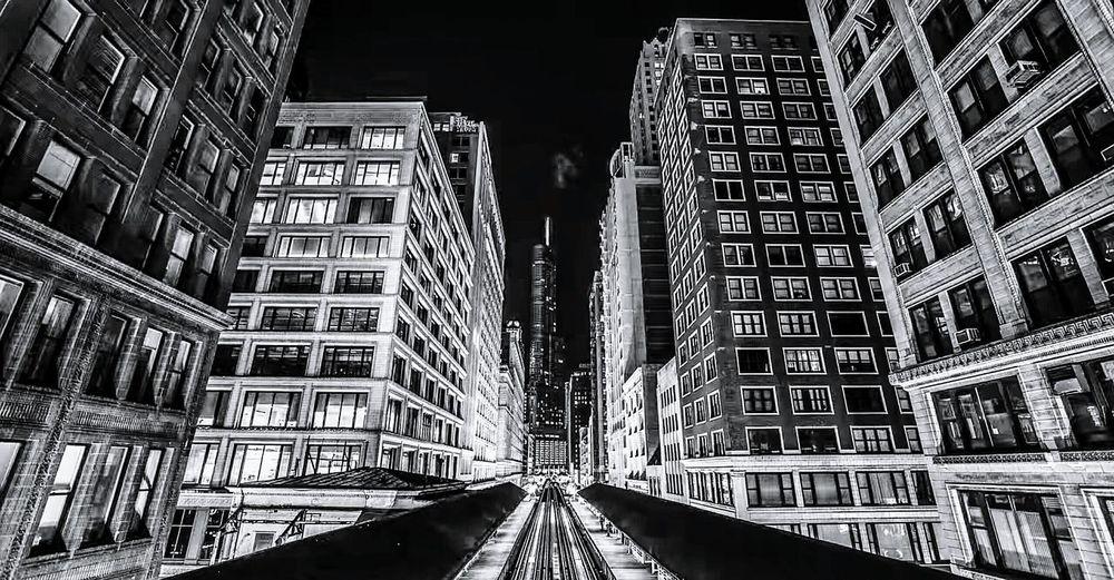 Road passing through city at night