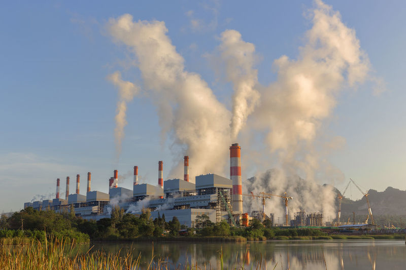 Coal power plant at sunrise Air Pollution Architecture Building Exterior Built Structure Chimney Cooling Tower Day Ecosystem  Emitting Environment Environmental Issues Factory Fumes Industry Nature No People Outdoors Pollution Sky Smog Smoke - Physical Structure Smoke Stack Water