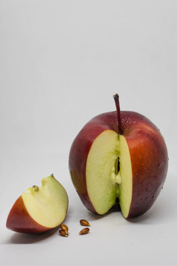 Close-up of apples on apple against white background