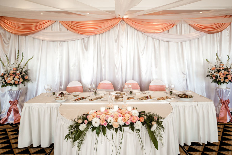 Wedding table setting at restaurant Banquet Holiday Romance Table Setting Table Arrangements Wedding Wedding Reception Arrangement Beauty Bouquet Celebration Event Curtain Decorated Flowers Indoors  No People Nobody Place Setting Restaurant Serving Size Table Tablecloth Wedding Banquet Wedding Chairs Wedding Table