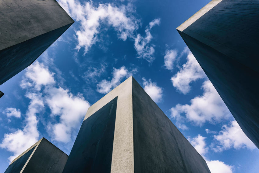 Berlin, Germany, August 31, 2018: Low Angle View of Concrete Blocks and Sky of Holocaust Memorial Berlin Germany 🇩🇪 Deutschland Horizontal Tourist Attraction  Architecture Blue Building Exterior Built Structure Cloud - Sky Color Image Concrete Concrete Block Day Famous Place Gray Grey History Holocaust Memorial Low Angle View Memorial Monument No People Outdoors Sky Sunlight