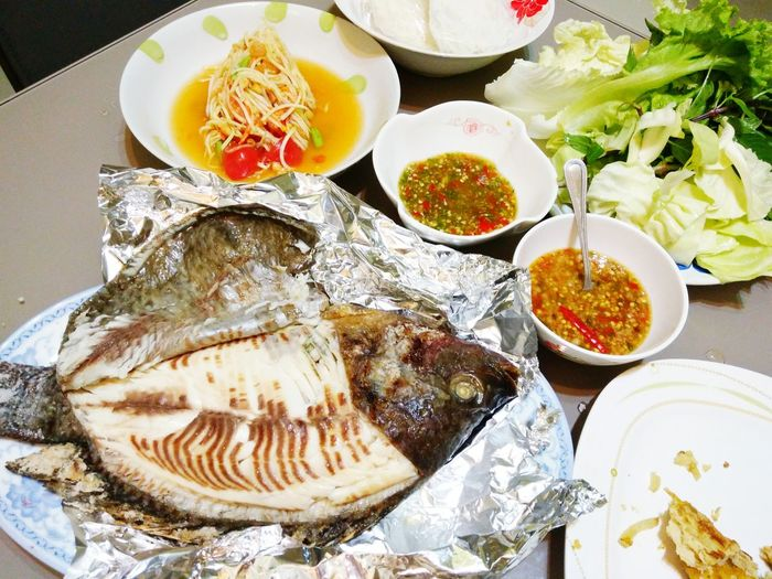 Food Food And Drink Healthy Eating Freshness Seafood No People Plate Directly Above Variation Bowl Indoors  Ready-to-eat Close-up Day ปลานิลย่าง เมี่ยงปลาเผา ส้มตำแซ่บๆ