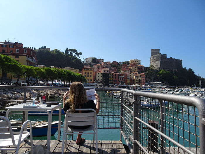 Castello Di Lerici Castle Lerici Reading Reading The News Sunday Morning City Clear Sky People Real People Rear View Sea Sea And Sky Sea Side Life Sitting Sky Water