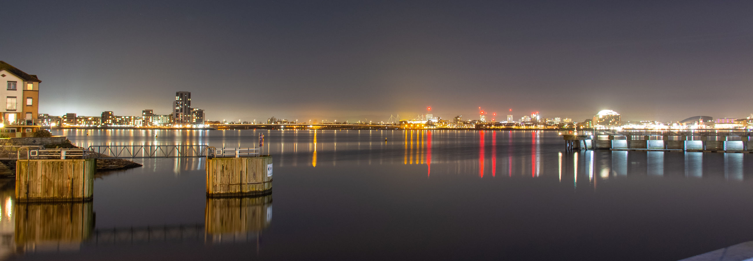water, sky, reflection, illuminated, waterfront, architecture, building exterior, built structure, nature, night, no people, city, building, sea, outdoors, scenics - nature, standing water, cityscape, skyscraper
