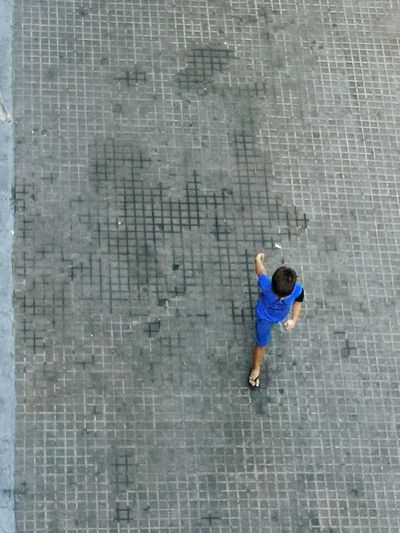High angle view of man walking on wall