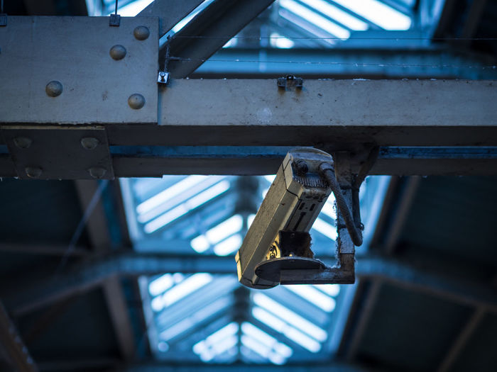 Low Angle View Of Old Security Camera In Train Station