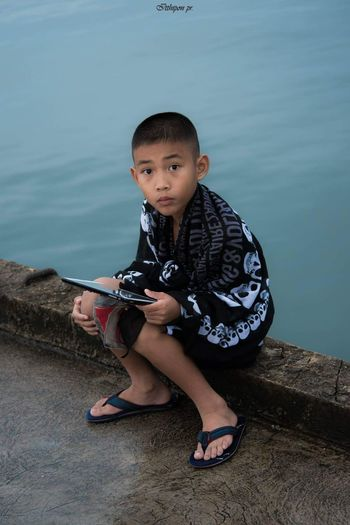 EyeEm Selects Portrait Child Full Length Water Childhood Looking At Camera Musical Instrument Boys Sitting Males