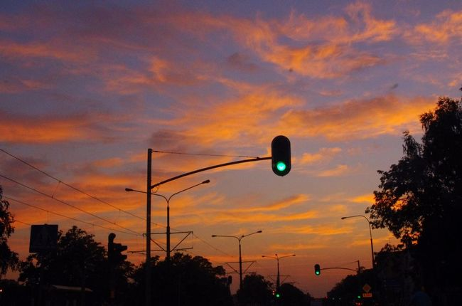 Polish Sunset Beauty In Nature City Cloud - Sky Day Elbląg, Low Angle View Nature No People Outdoors Road Scenics Silhouette Sky Sunset Traffic Lights