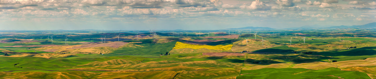 Wind turbines seen from the Steptoe Butte State Park lookout. One of the largest wind farms in the country. Seen in the Palouse area of Eastern Washington state, USA. Landscape Environment Scenics - Nature Beauty In Nature Nature Sky No People Land Mountain Tranquil Scene Panoramic Outdoors Travel Destinations Green Color Rolling Landscape Dramatic Landscape Steptoe Butte Steptoe Butte State Park Turbines Wind Power Generation Electrical Equipment Power In Nature Energy Renewable Energy Propellers Wind Farm Agriculture Agricultural Field Colorful Aerial View Cloud - Sky Non-urban Scene Rural Scene Fields
