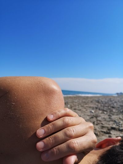 Body EyeEm Selects Human Hand Abdomen Sea Beach Sand Human Back Muscular Build Nail Polish Massaging Summer Calm Sun Shining Sunrise Scenics Sunbeam Streaming Sunset Coastline Tranquil Scene Manicure Suntan Lotion Horizon Over Water Shoulder Ocean Fingernail Shore Holiday Moments International Women's Day 2019