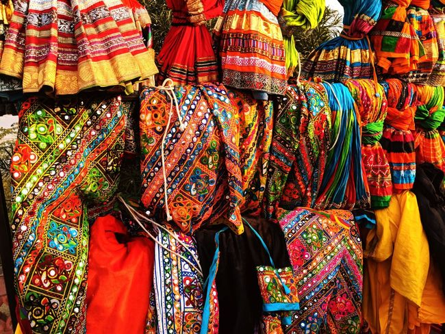 Traditional dresses of Rajasthan Colourful Dresses Traditional Dresses  Rajasthani Dresses For Sale Retail  Multi Colored Variation Market Hanging Textile Outdoors