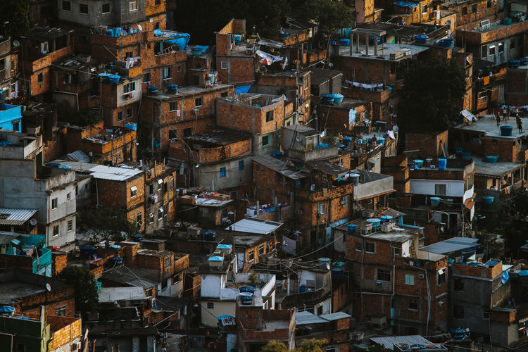 Countless of brick houses in the Rocinha favela in Rio de Janeiro Architecture Brazil Houses Poor  Rio De Janeiro Architecture Building Building Exterior Built Structure City Crowd Crowded Dense Favela Ghetto High Angle View Housing Housing Settlement Outdoors Poverty Residential District Slum Social Issues Society Tropical Climate