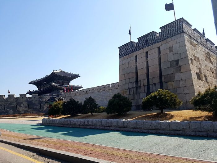 Asphalt road blends with the old castle Outdoors Architecture Sunny Day No People Korean Traditional Architecture Korea Photos Janganmun