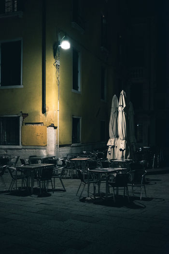 Architecture Arts Culture And Entertainment Building Building Exterior Built Structure Chair Electric Lamp Full Length Illuminated Lighting Equipment Night Occupation People Real People Seat Sitting Street Table Venice