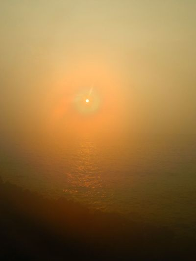 Sun Scenics Sunset Tranquil Scene Beauty In Nature Tranquility Glowing Majestic Idyllic Orange Color Atmospheric Mood Nature Sky Moon Sea Dramatic Sky Atmosphere Seascape Water Back Lit