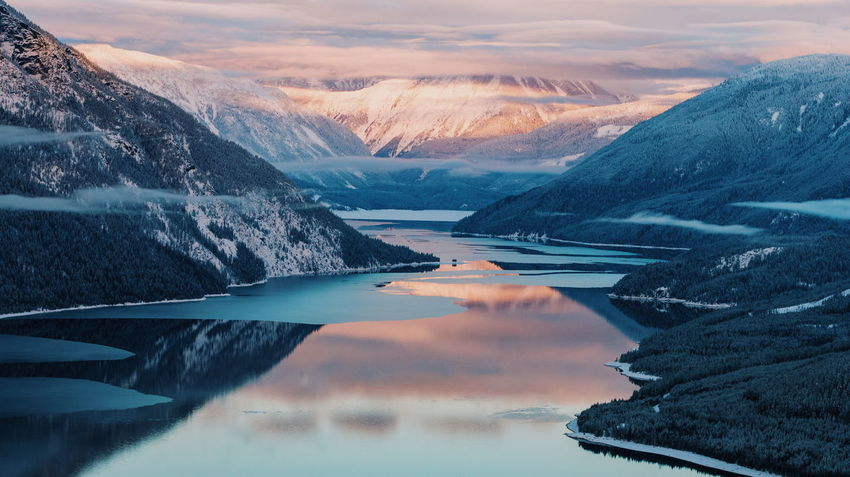 Sunrise Sunset Sunlight Mountain Range Canada Colorful Clouds And Sky Cloudscape Aerial View Aerial Shot Scenics Mountain Nature Sunset Reflection Water Snow Beauty In Nature Lake Landscape Outdoors Winter Travel Destinations Tranquility Mountain Range No People Cold Temperature Day Sky Fresh On Market 2018 Shades Of Winter