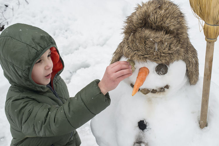 Snow Snowman Snowman⛄ Making Winter Cold Temperature Cold Play Playng Child Boy Childhood Warm Clothing Clothing Hat Real People Boys Leisure Activity One Person Lifestyles Knit Hat Females Nature Covering Innocence Hood - Clothing Extreme Weather