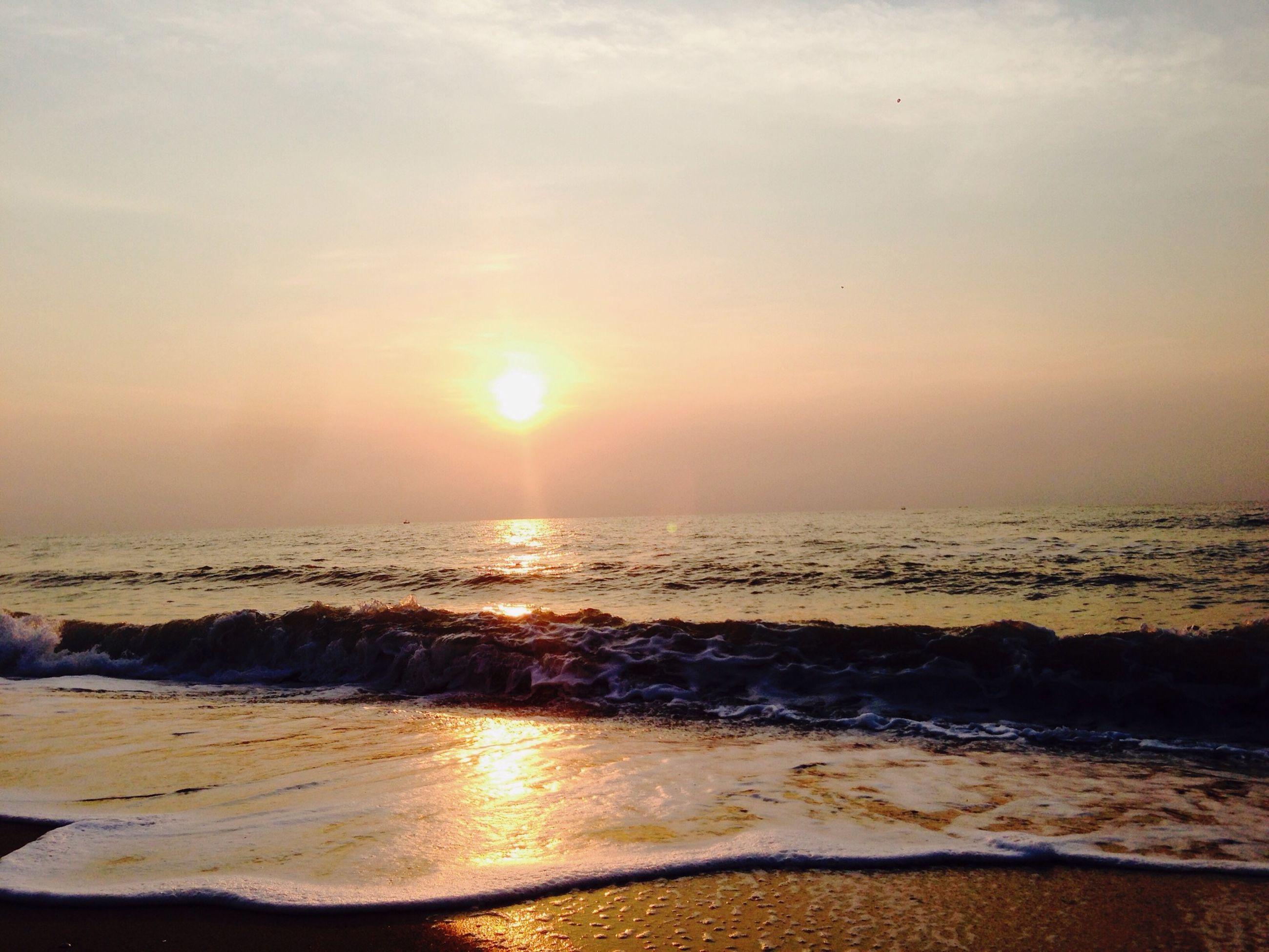 sea, sunset, beach, horizon over water, water, scenics, sun, shore, beauty in nature, tranquil scene, tranquility, wave, sky, idyllic, orange color, nature, sand, sunlight, surf, reflection