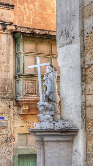 Religious statue in Valetta, Malta Architecture Art And Craft Building Exterior Built Structure Day Human Representation Low Angle View Male Likeness No People Outdoors Sculpture Statue Travel Destinations