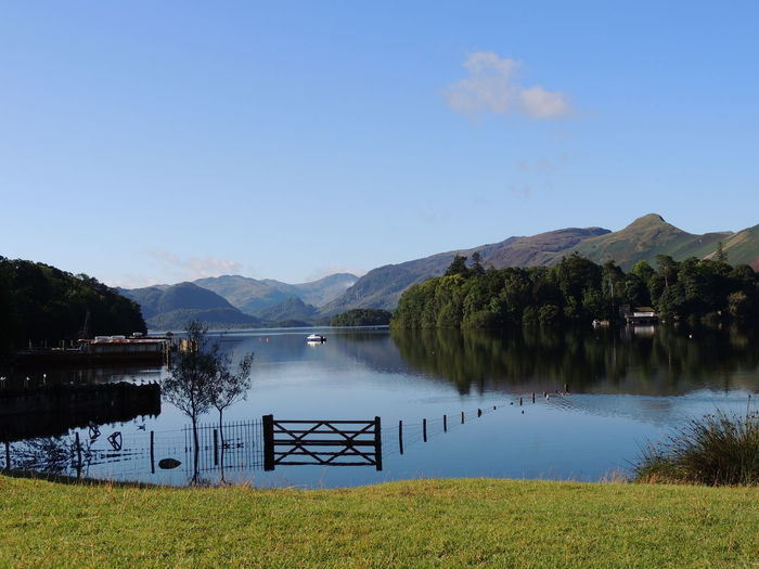 Derwent Water Derwentwater Lake District Architecture Beauty In Nature Blue Built Structure Clear Sky Day Grass Lake Lakescape Lakescape Collection Mountain Mountain Range Nature No People Outdoors Reflection Scenics Sky Tranquil Scene Tranquility Tree Water