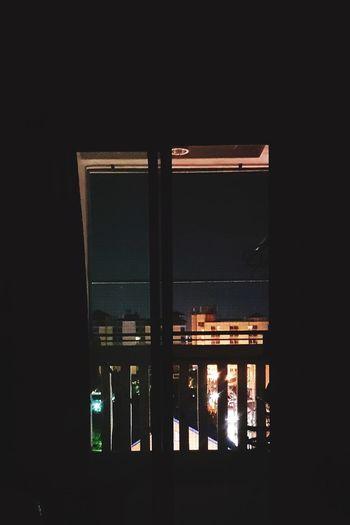 Illuminated building seen through window