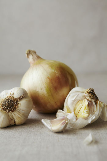 Close-up of garlic on white table