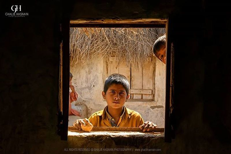 Shot from the Exhibition 2015 THARPARKAR Photoexhibition Nikon Ghalibhasnain @vsco.pk Streets Kids Window Frame Hopes Nagarparkar Mithi Sind Pakistan