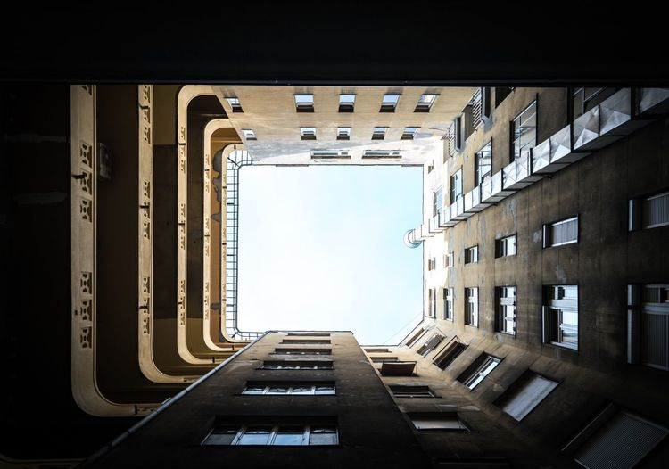 Plug It Architecturelovers Tunnel Vision Magyarország Hungary Budapest Architecture Built Structure Building Sky Building Exterior No People Window City Directly Below Day The Way Forward Direction Clear Sky Residential District Outdoors Low Angle View Apartment