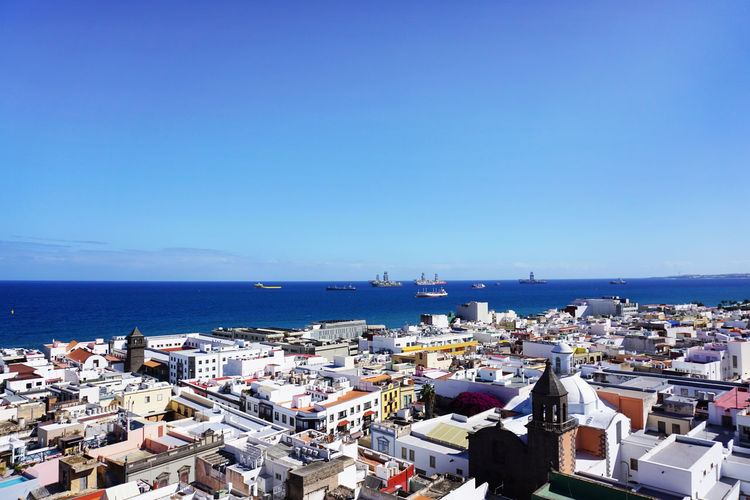 Architecture Built Structure Building Exterior Building City Sky Cityscape Day High Angle View Outdoors Sea Water Blue Clear Sky Horizon Nature Copy Space Horizon Over Water No People Travel Destinations Bay Marina Las Palmas De Gran Canaria