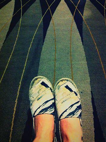 On the carpet Shoes Relaxing Enjoying Life