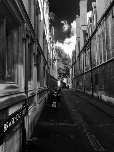 Architecture Building Exterior Built Structure Street City Road The Way Forward Sky Transportation Building Diminishing Perspective Mode Of Transport City Street Cloud - Sky Cloud Long City Life Outdoors Day Narrow Oxford Brasenose Lane MonochromePhotography
