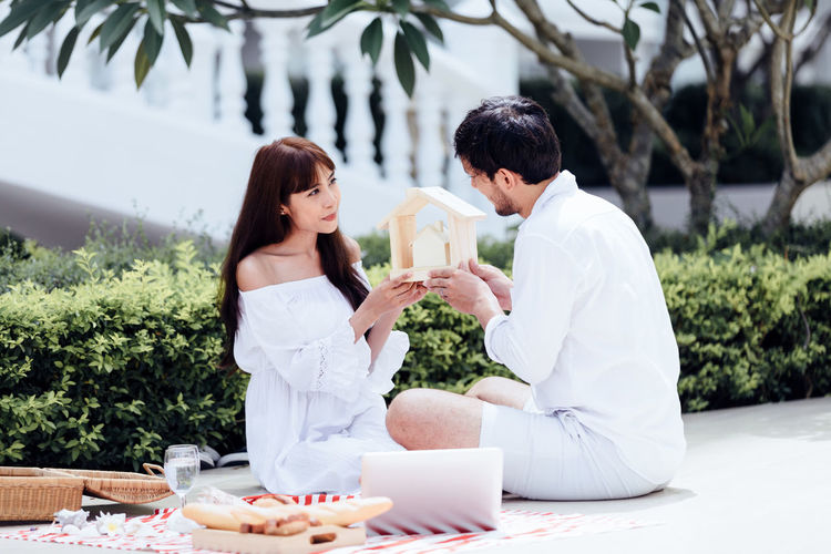 Two People Young Adult Young Women Togetherness Adult Women Men Young Men Plant Emotion Real People Nature Day Lifestyles Casual Clothing Side View Table Food And Drink Sitting Couple - Relationship Positive Emotion Outdoors