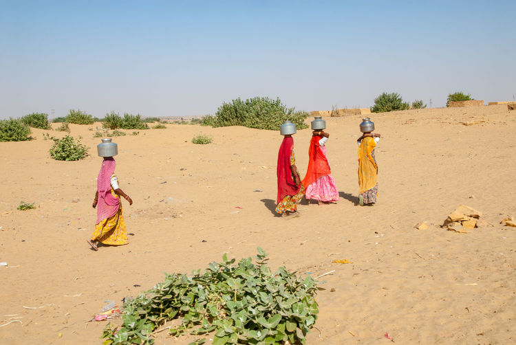 Women carrying water in That desert Carrying Drought India Thirst Arid Climate Desert Dry Outdoors People Rajasthan Real People Sand Thar Thar Desert Traditional Clothing Water Women