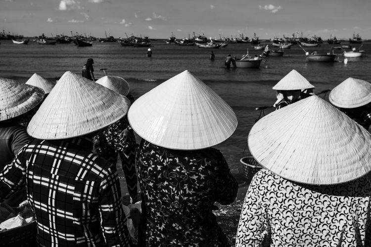 The daily activities in a fishing village in Mui Ne, Vietnam. Real People Land Group Of People Nature Incidental People Water Day People Outdoors Men Hat Sea Sky Crowd Beach Asian Style Conical Hat Protection Occupation Rural Scene Capture The Moment Bamboo Sharp Vietnam Ocean Fishing Black And White