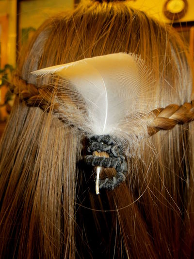 Close-up of feather on woman hair