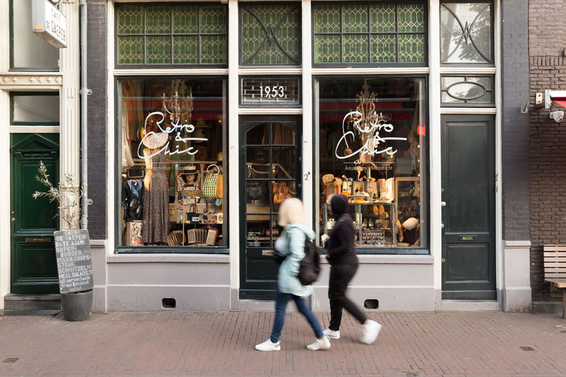 Amsterdam Netherlands Adult Architecture Blurred Motion Boutique Building Exterior Built Structure Consumerism Day Entrance Full Length Glass - Material Holland Outdoors People Real People Retail  Retail Display Shopping Staalstraat Store Store Window Two People Window Women