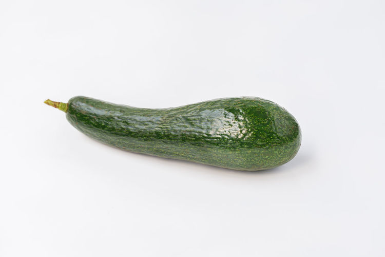 High angle view of green pepper against white background