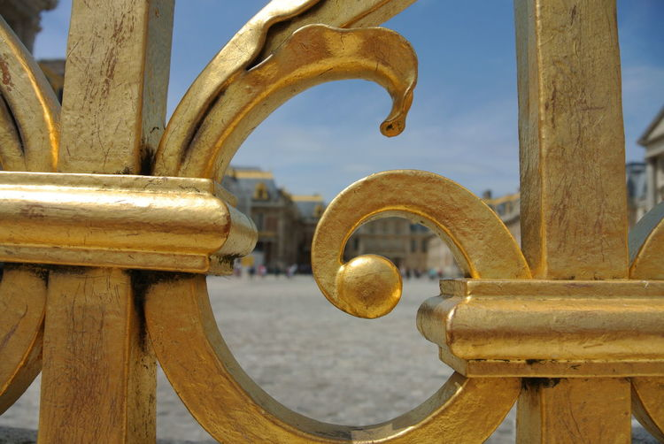 Close-up of gold colored metallic gate at park