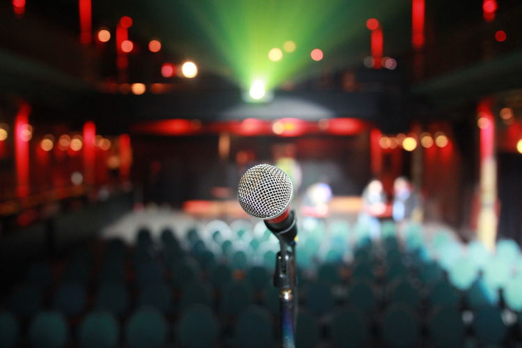 Close-up of microphone at stage theater
