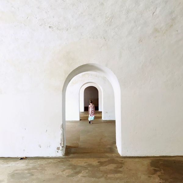 Del Morro. This Is Latin America Arch One Person Real People Standing Built Structure Indoors  Architectural Detail Minimalist Architecture Building Interior Wall - Building Feature Casual Clothing Lifestyles Architecture Leisure Activity Entrance Child Building White Color