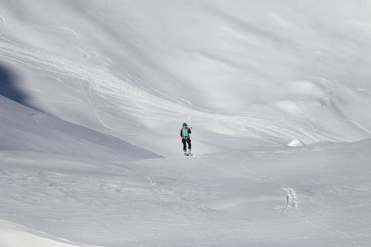 Woman skiing on snowcapped mountain