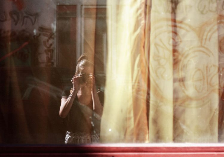 Reflection of woman in water window