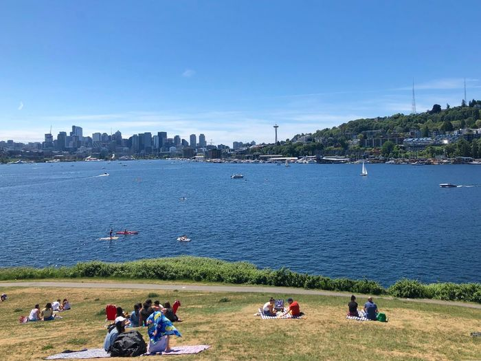 Picnicking with a view Having Fun Seattle Summer Beauty In Nature Summertime EyeEm Gallery EyeEm Best Shots Eye4photography  Enjoying Life Urban Skyline Water Sky Plant Tree Group Of People Nature Crowd City Lifestyles Outdoors Leisure Activity Architecture Clear Sky Real People My Best Photo The Mobile Photographer - 2019 EyeEm Awards