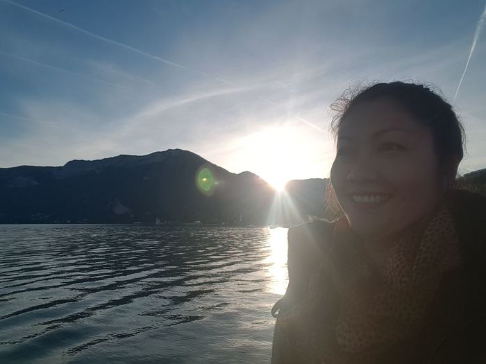 Beauty In Nature Emotion Front View Happiness Headshot Leisure Activity Lens Flare Lifestyles Looking At Camera Nature One Person Outdoors Portrait Real People Scenics - Nature Sea Sky Smiling Sun Sunlight Water