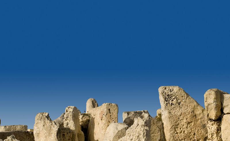 Hagar Qim Megalithic Temples Hagar Qim Hagar Qim Prehistoric Site, Malta Ancient Civilization Beauty In Nature Blue Clear Sky Copy Space Day Low Angle View Megalith Megalithic Nature No People Outdoors Prehistoric Prehistoric Life Rock - Object Sky Tranquility Travel Destinations