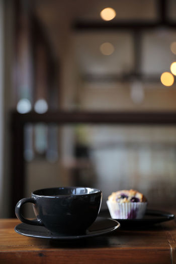 Coffee cup on table