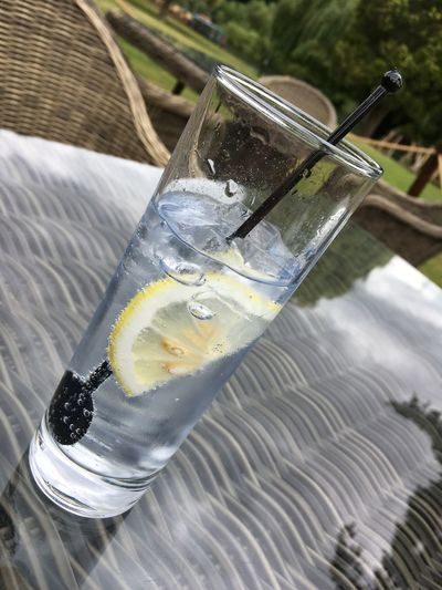 Alcohol Close-up Cold Temperature Day Drink Drinking Glass Food Food And Drink Freshness Gin And Tonic Ice Ice Cube Lemon Lemonade No People Outdoors Refreshment Stirrers Tonic Water Twizzlers Water