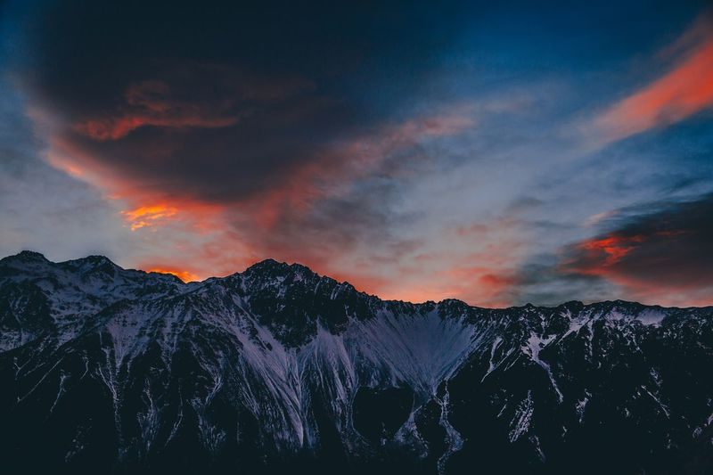 View Of Mountains Against Sky During Sunset
