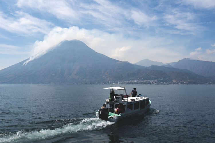 Central America Guatemala Beauty In Nature Cloud - Sky Day Mode Of Transportation Motion Mountain Mountain Range Nature Nautical Vessel Outdoors Real People Scenics - Nature Sea Sky Transportation Travel Water Waterfront Wave Pattern