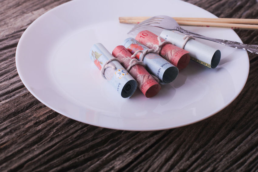 Malaysian money on white plate ready to serve. Bribe concept. Bank Bill Bridge Bus Concept Corruption Dinner Dollar Eat Economy Exchange Fork Malaysia Money Note Pension Plate Ringgit Savings Trade Wealth Wood